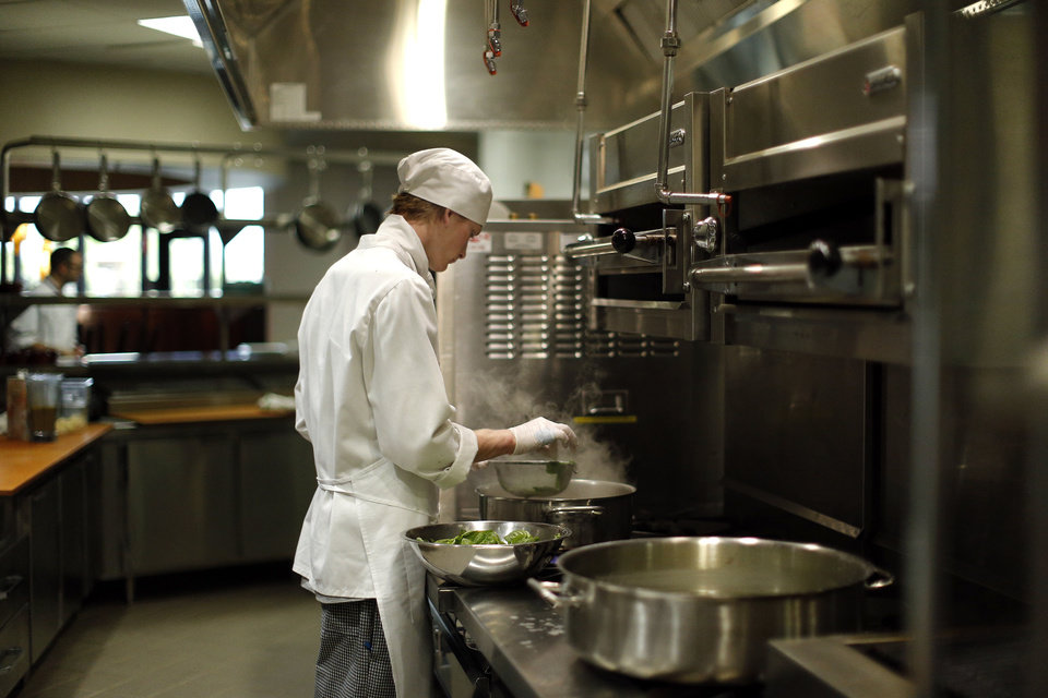 Photo - Jeremy Williamson works in the culinary arts program kitchen at Francis Tuttle Technology Center.  Photo by Sarah Phipps, The Oklahoman  SARAH PHIPPS - SARAH PHIPPS