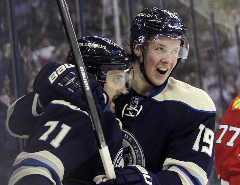 Photo - Columbus Blue Jackets' Nick Foligno, left, celebrates his goal against the Florida Panthers with teammate Ryan Johansen during the second period of an NHL hockey game on Saturday, Feb. 1, 2014, in Columbus, Ohio. (AP Photo/Jay LaPrete)