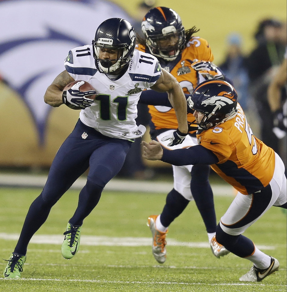 Photo - Seattle Seahawks' Percy Harvin, left, runs past Denver Broncos' Matt Prater en route to a touchdown during the second half of the NFL Super Bowl XLVIII football game Sunday, Feb. 2, 2014, in East Rutherford, N.J. (AP Photo/Ben Margot)