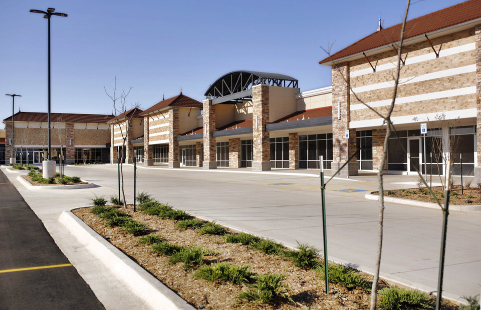 Photo - Updated photos of the Northeast Town Center, in the 1100 block of NE 36, which is now leasing space. When the Northeast Shopping Center first opened in the early 1960s, it was a source of pride for northeast Oklahoma City — home to a Safeway grocery store, Cherry's Cafeteria, a TG&Y and the same sort of variety retailers featured in similar developments popping up throughout the city. But by the 1990s, the shopping center was a ghost of its former self, littered with empty storefronts, bars on shop windows and weeds in a largely vacant sprawling parking lot. The history of the property was enough to provoke an outburst by John Pettis early in his first term as the Ward 7 City Councilman against the owner, Charles Shadid. But after two years of discussions, Pettis and Shadid announced a redevelopment of the shopping center that is expected to include a grocer as its anchor tenant.