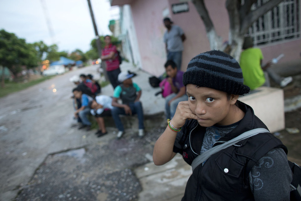 Photo - In this June 19, 2014 photo, a 14-year-old Guatemalan girl traveling alone waits for a northbound freight train along with other Central American migrants, in Arriaga, Chiapas state, Mexico. The United States has seen a dramatic increase in the number of Central American migrants crossing into its territory, particularly children traveling without any adult guardian. More than 52,000 unaccompanied children have been apprehended since October. (AP Photo/Rebecca Blackwell)