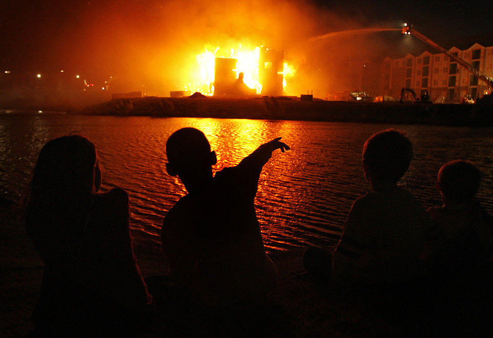 A group of children look on as they watch firefighters battle a four-story apartment fire near the intersection of Covell Road and Kelly Avenue on Monday, Oct. 19, 2009, in Edmond, Okla. Photo by Chris Landsberger, The Oklahoman