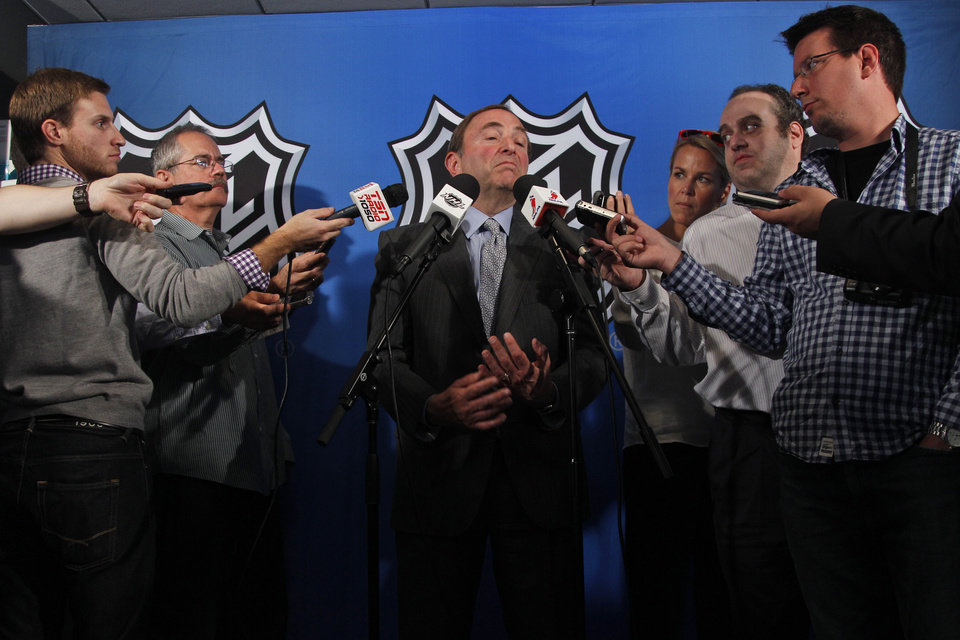 Photo -   NHL commissioner Gary Bettman speaks to reporters after meeting with the NHL Players' Association representatives during a news conference at NHL headquarters, Wednesday, Sept. 12, 2012 in New York. The NHL and the players' association exchanged proposals on Wednesday as negotiations resumed in an effort to avoid a lockout this weekend. (AP Photo/Mary Altaffer)