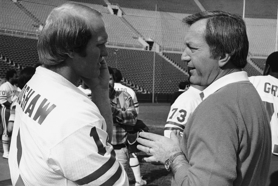 Pittsburgh Steelers quarterback Terry Bradshaw, left, talks with New England Patriots coach Chuck Fairbanks, Jan. 23, 1979 in Los Angeles, where Fairbanks will coach the AFC squad in Monday night's upcoming Pro-Bowl. The Pro-Bowl game might be Fairbanks last appearance as professional club's coach as he is currently involved in a contract dispute with the Patriots. Bradshaw is slated to quarterback the AFC team. (AP Photo/Wally Fong)