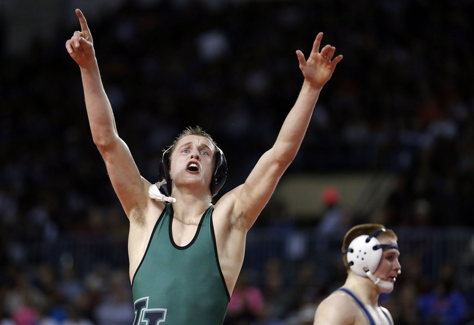 Photo - STATE TOURNAMENT / CELEBRATION: Norman North's Hayden Hansen celebrates his win over Edmond North's Josh Breece in the 126-pound match during the state high school wrestling tournament at the State Fair Arena in Oklahoma City,  Friday, Feb. 22, 2013. Photo by Sarah Phipps, The Oklahoman