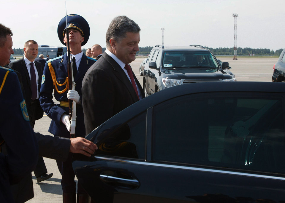 Photo - Ukrainian President Petro Poroshenko gets in a car upon arrival in Minsk, Belarus on Tuesday, Aug. 26, 2014. Poroshenko arrived in Minsk on Tuesday for discussions with Russia and Ukraine with a view to creating a new political impulse towards finding a political, sustainable solution to the situation in Ukraine. (AP Photo/ Dmitry Brushko)