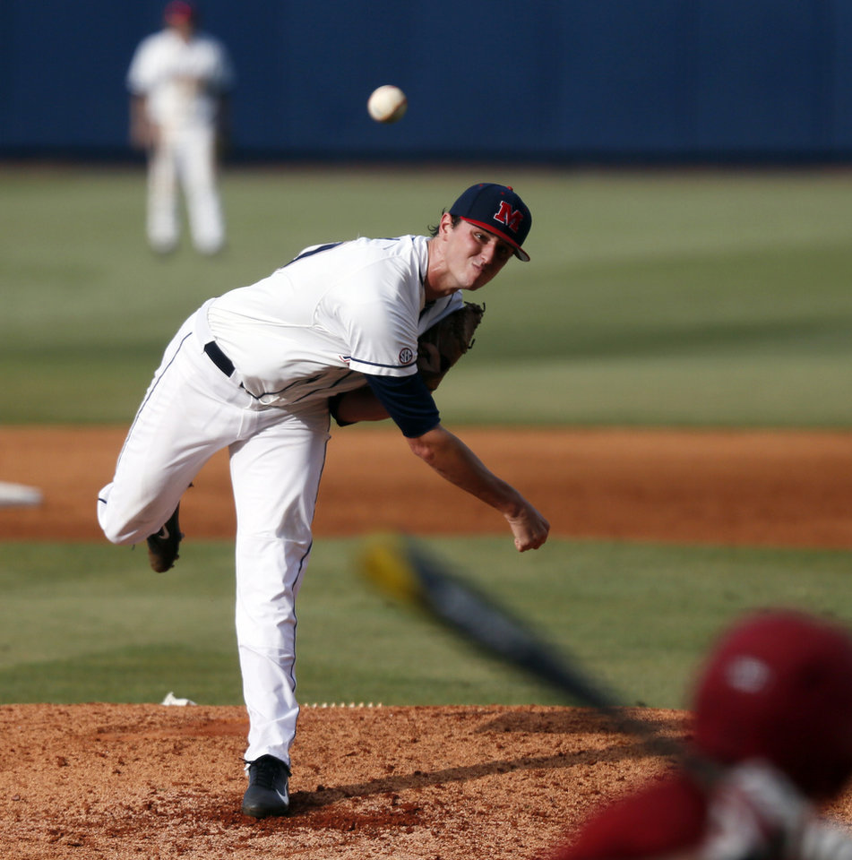 Photo - Mississippi pitcher Chris Ellis pitches to a Jacksonville State batter during the third inning of an NCAA college baseball regional tournament game in Oxford, Miss., Saturday, May 31, 2014. (AP Photo/Rogelio V. Solis)