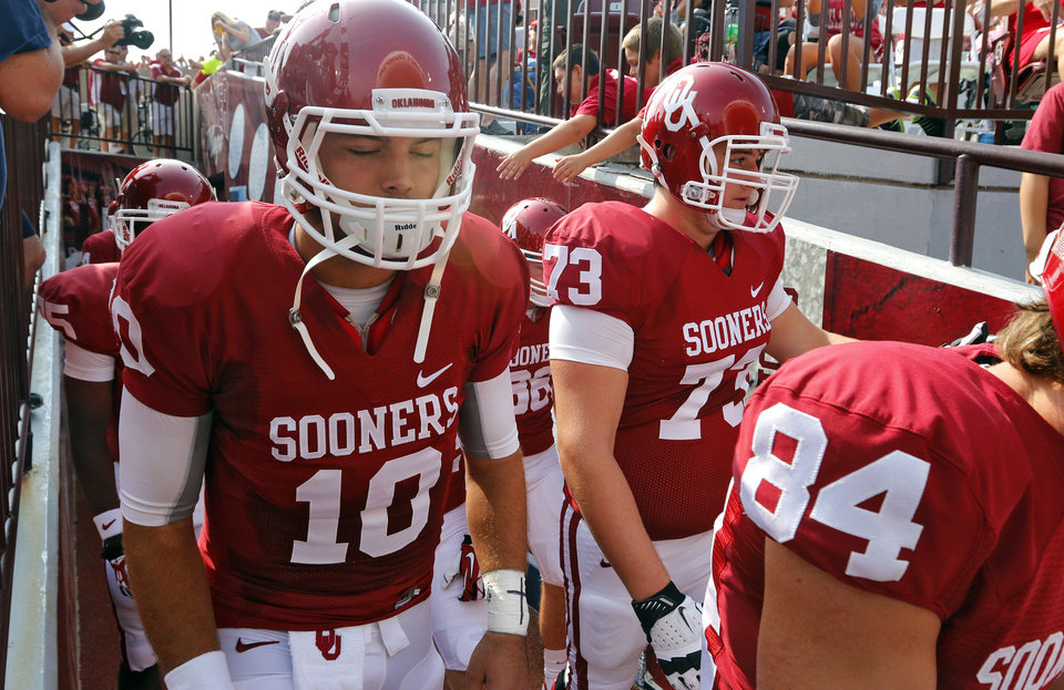 Oklahoma's Blake Bell (10) makes his way onto the field during the college football game between the University of Oklahoma Sooners (OU) and the University of Tulsa Hurricanes (TU) at the Gaylord-Family Oklahoma Memorial Stadium on Saturday, Sept. 14, 2013 in Norman, Okla.  Photo by Chris Landsberger, The Oklahoman