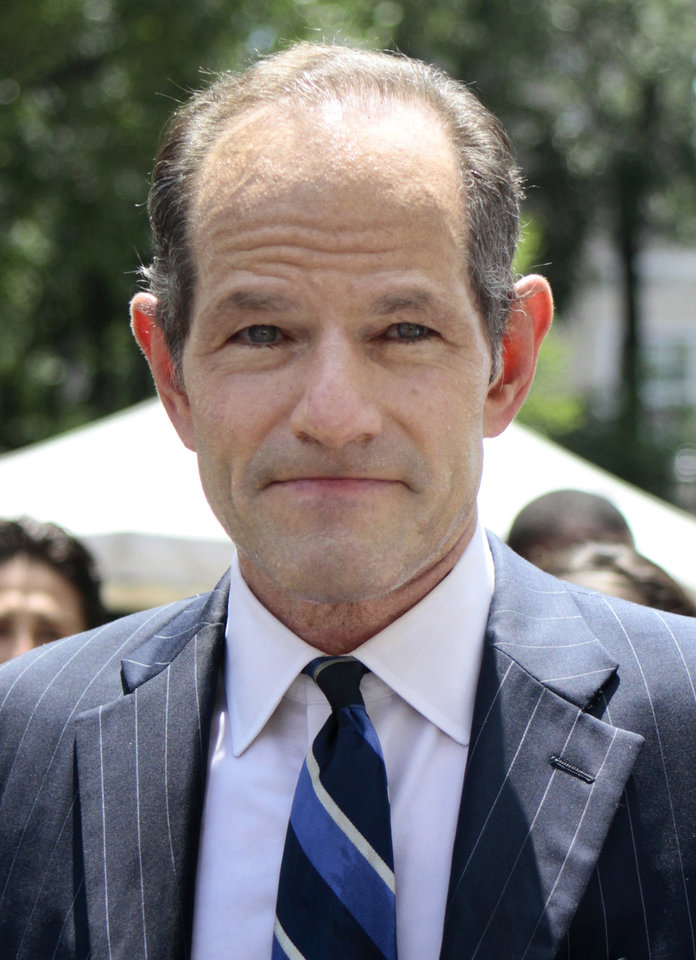 Photo - Eliot Spitzer tries to collect signatures for his run for New York City Comptroller in New York, Monday, July 8, 2013. Former Gov. Eliot Spitzer, who stepped down in 2008 amid a prostitution scandal, says he is planning a political comeback with a run for New York City comptroller.(AP Photo/Bethan McKernan)