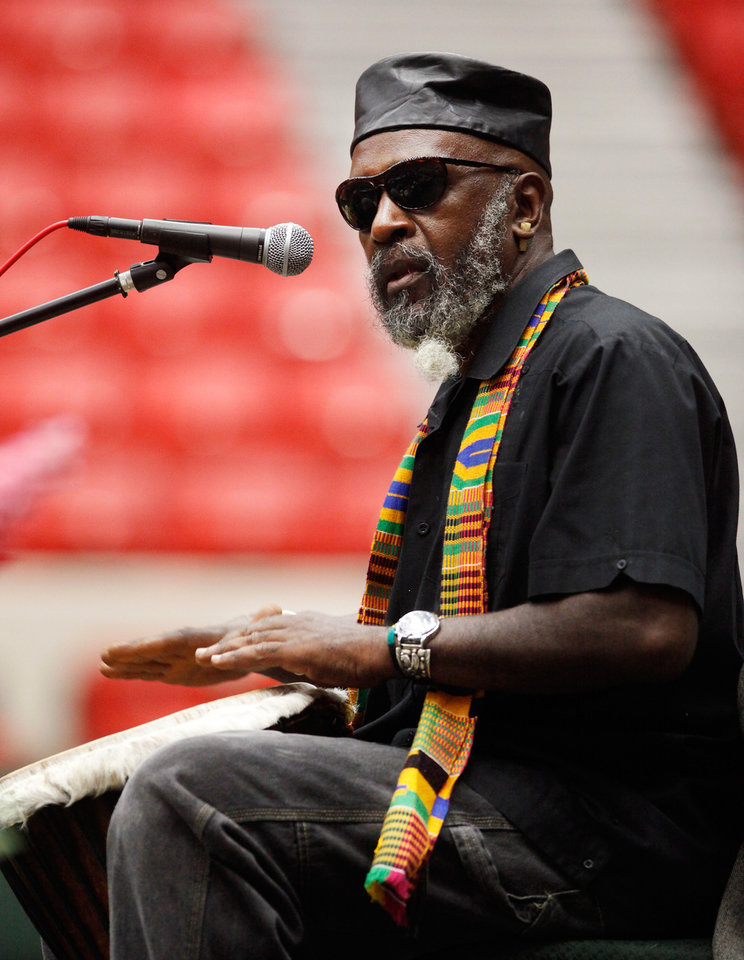 Photo - A man known as Jaruba plays a drum and sings a song he wrote as a  tribute to Clara Luper.  About 2,500 people celebrated the life and legacy of Oklahoma City civil rights pioneer Clara Mae Shepard Luper  during a lively service in the Cox Convention Center that lasted more than three hours, Friday,  June 17, 2011.  Luper died  last week at the age of 88. Photo by Jim Beckel, The Oklahoman