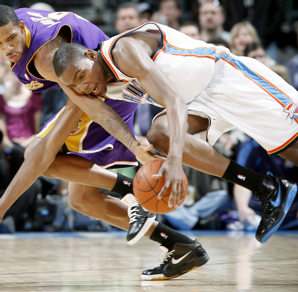 Oklahoma City's Kevin Durant fights with Trevor Ariza of the Lakers for the ball during the NBA basketball game between the Los Angeles Lakers and the Oklahoma City Thunder at the Ford Center,Tuesday, Feb. 24, 2009. The Thunder lost 107-93.  PHOTO BY BRYAN TERRY, THE OKLAHOMAN