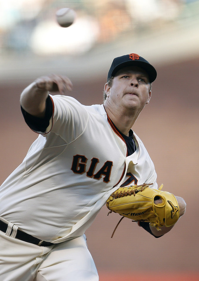 Photo - San Francisco Giants pitcher Matt Cain throws against the San Diego Padres during the first inning of a baseball game in San Francisco, Monday, June 23, 2014. (AP Photo/Tony Avelar)