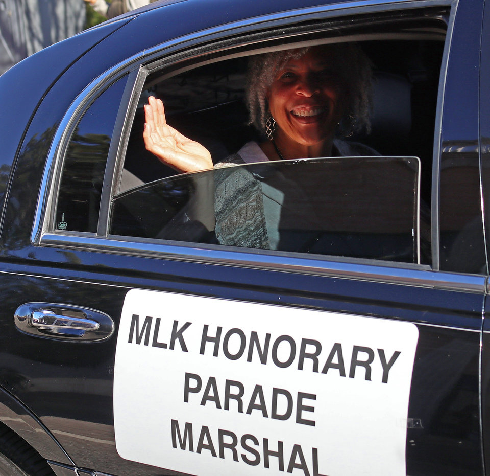 Photo - Angela Monson, one of the Honorary Parade Marshal's, waves to the crowd at the MLK Day Parade during celebration of Dr. Martin Luther King, Jr. holiday, Monday, January 20, 2019. [Photo by Doug Hoke/The Oklahoman]