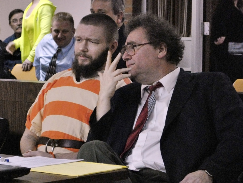 Photo - Kyle Flack, left, of Ottawa, Kan., sits with his court-appointed lawyer, Ronald Evans, head of the Kansas Death Penalty Defense Unit in Topeka, during a hearing in Franklin County District Court Tuesday, March 11, 2014, in Ottawa, Kan. Flack, 28, is charged with capital murder and other charges in the slaying of four people, including an 18-month-old girl, at a farm in rural eastern Kansas last spring. (AP Photo/The Ottawa Herald, Abby Eckel, Pool)