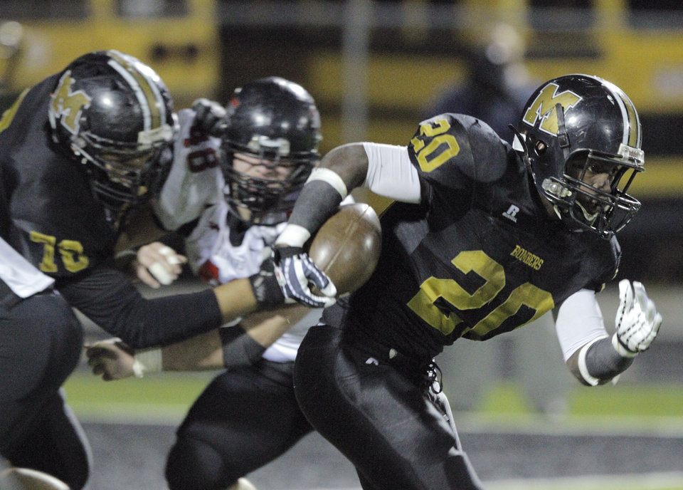 Photo - Midwest City's James Flanders (20) during a high school football game between Midwest City and Westmoore in Midwest City, Friday, Nov. 11, 2011.  Photo by Garett Fisbeck, for The Oklahoman