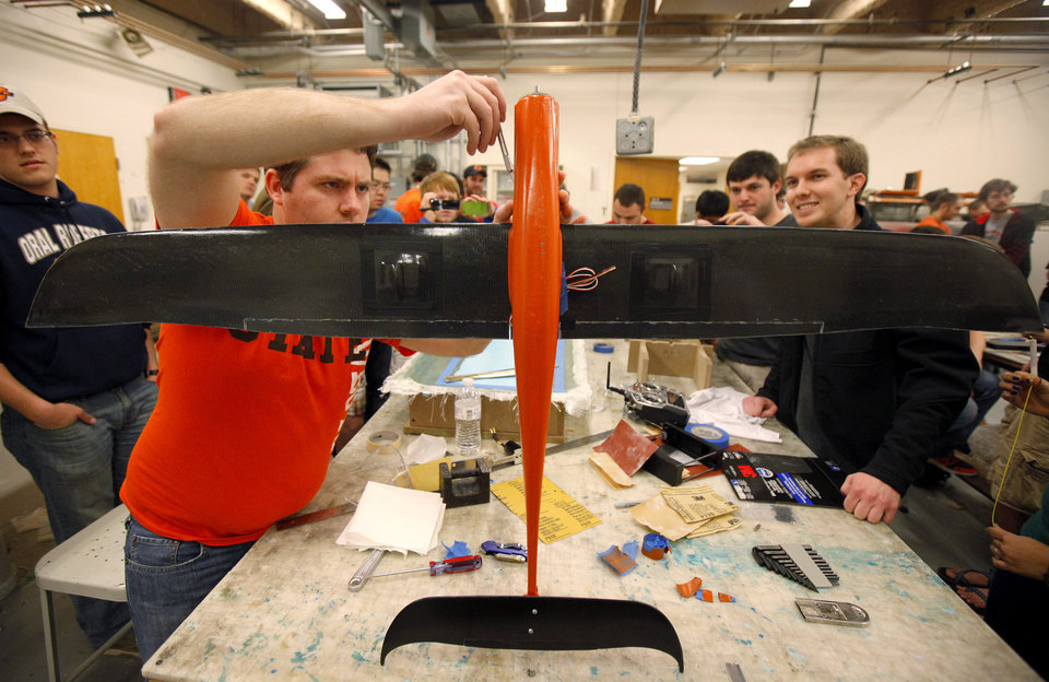 Oklahoma State University senior Scott Hood works on his team�s unmanned aerial vehicle. Photo by Bryan Terry, The Oklahoman