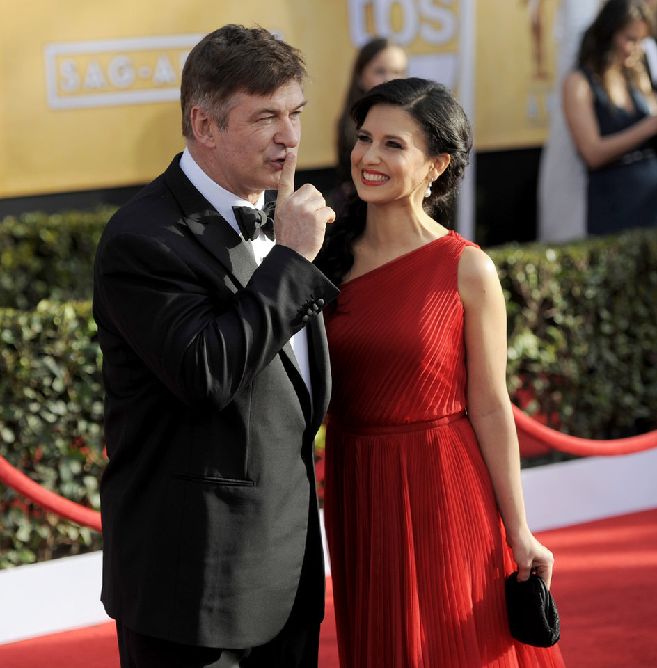 Photo - Alec Baldwin, left, and Hilaria Thomas arrive at the 19th Annual Screen Actors Guild Awards at the Shrine Auditorium in Los Angeles on Sunday, Jan. 27, 2013. (Photo by Chris Pizzello/Invision/AP)