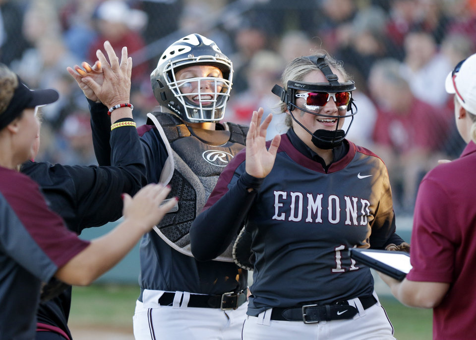 Photo - EHS catcher Leah McNally and pitcher Jill Dickson come off the field during the 6A Fast Pitch Championship game between Edmond Memorial and Owasso at the Ball Fields at Firelake in Shawnee, Saturday, October 19, 2019. [Doug Hoke/The Oklahoman]