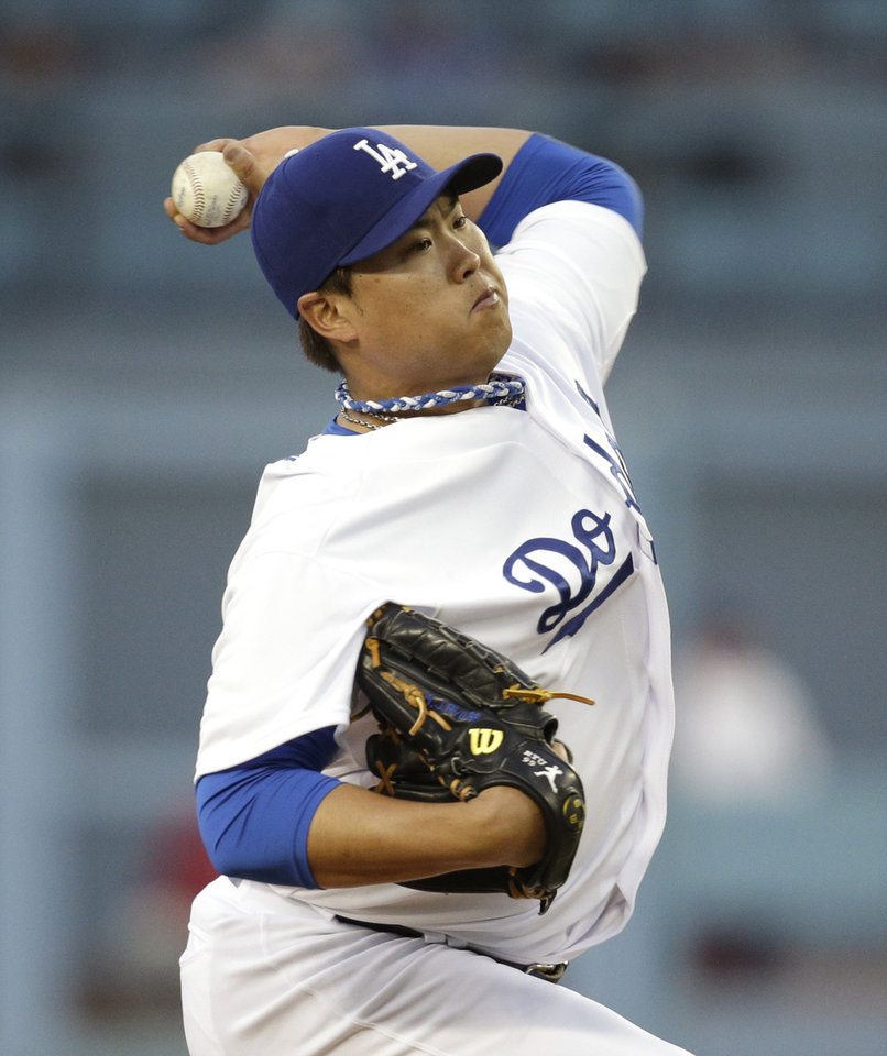 Photo - Los Angeles Dodgers starting pitcher Hyun-Jin Ryu, of South Korea, throws against the Philadelphia Phillies during the first inning of a baseball game on Tuesday, April 22, 2014, in Los Angeles. (AP Photo/Jae C. Hong)