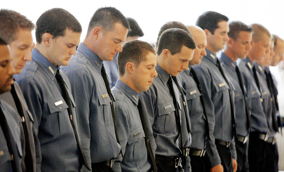 Oklahoma City Fire Department recruits bow their heads in prayer during a commencement ceremony. Photo by Paul B. Southerland, The Oklahoman