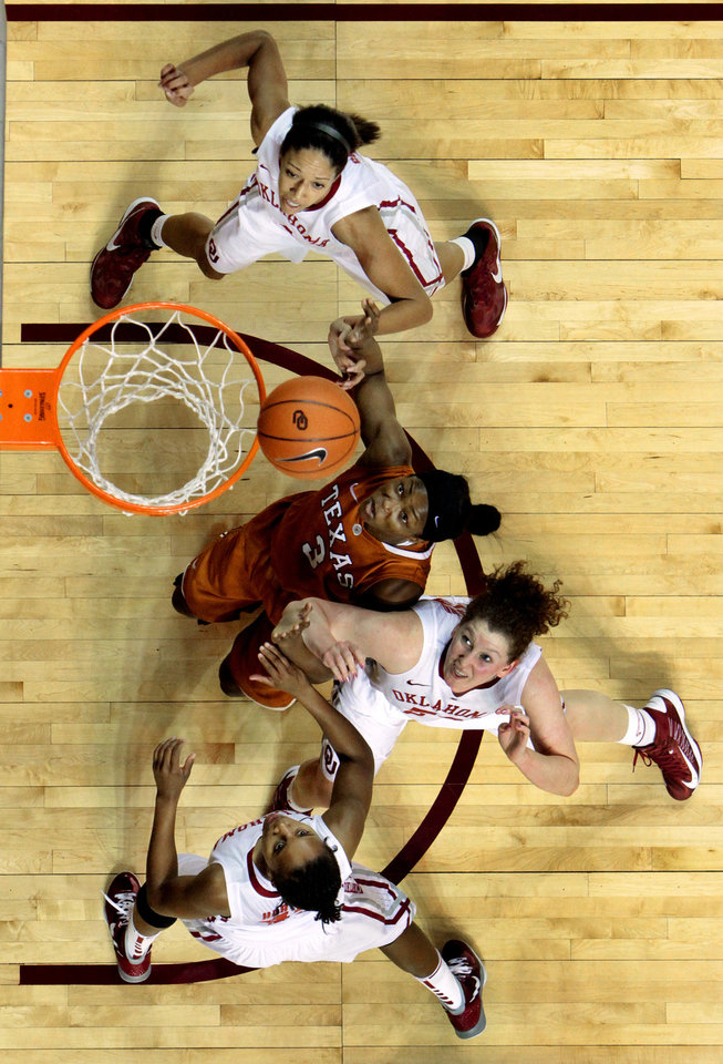 Oklahoma Sooners' Nicole Griffin top, Joanna McFarland, and Jasmine Hartman, bottom, fight Texas Longhorn's Nneka Enemkpali (3) for position on a rebound as the University of Oklahoma Sooners (OU) defeat the University of Texas (UT) Longhorns 69-56 in NCAA, women's college basketball at The Lloyd Noble Center on Saturday, Jan. 19, 2013 in Norman, Okla. Photo by Steve Sisney, The Oklahoman