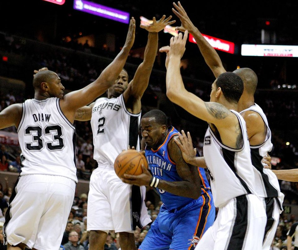 Oklahoma City's Kendrick Perkins (5)  gets caught between San Antonio's Boris Diaw (33), Kawhi Leonard (2), Daniel Green (4), and Tim Duncan (21) during Game 2 of the Western Conference Finals between the Oklahoma City Thunder and the San Antonio Spurs in the NBA playoffs at the AT&T Center in San Antonio, Texas, Tuesday, May 29, 2012. Photo by Bryan Terry, The Oklahoman