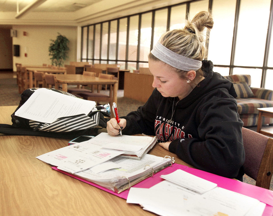 Desiree Shipp studies on Monday for final exams at OCCC in southwest Oklahoma City.