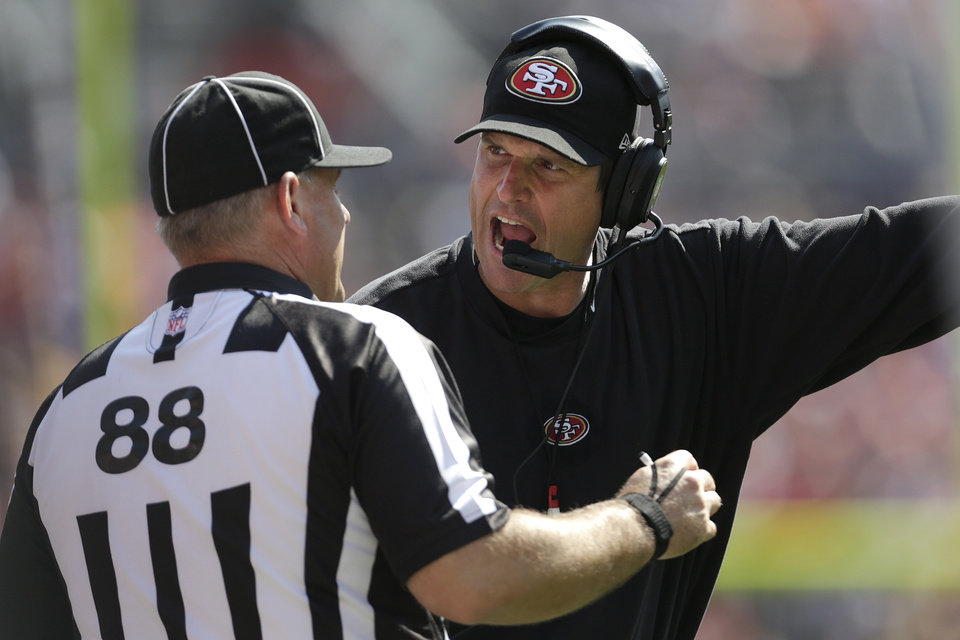 Photo -   FILE - This Aug. 26, 2012 file photo shows San Francisco 49ers head coach Jim Harbaugh, right, arguing with a replacement official during the second quarter of an NFL preseason football game against the Denver Broncos, in Denver. The NFL will open the regular season with replacement officials. League executive Ray Anderson has told the 32 teams that with negotiations remaining at a standstill between the NFL and the officials' union. The replacements will be on the field beginning next Wednesday night, Sept. 5, 2012 when the Cowboys visit the Giants to open the season. (AP Photo/Joe Mahoney, File)