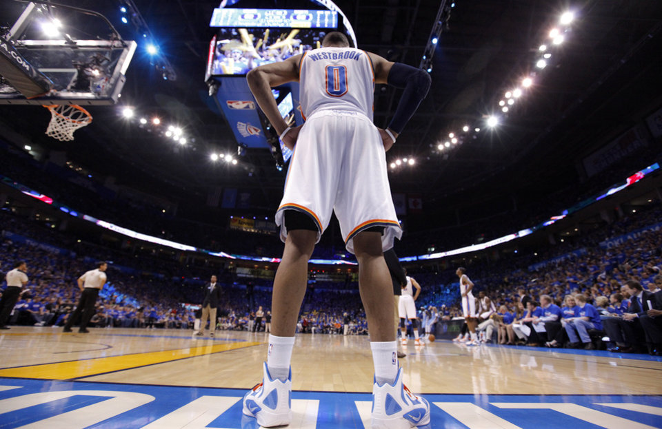 Photo - Oklahoma City's Russell Westbrook (0) stands on the baseline during the first round NBA playoff game between the Oklahoma City Thunder and the Denver Nuggets on Sunday, April 17, 2011, in Oklahoma City, Okla. Photo by Chris Landsberger, The Oklahoman