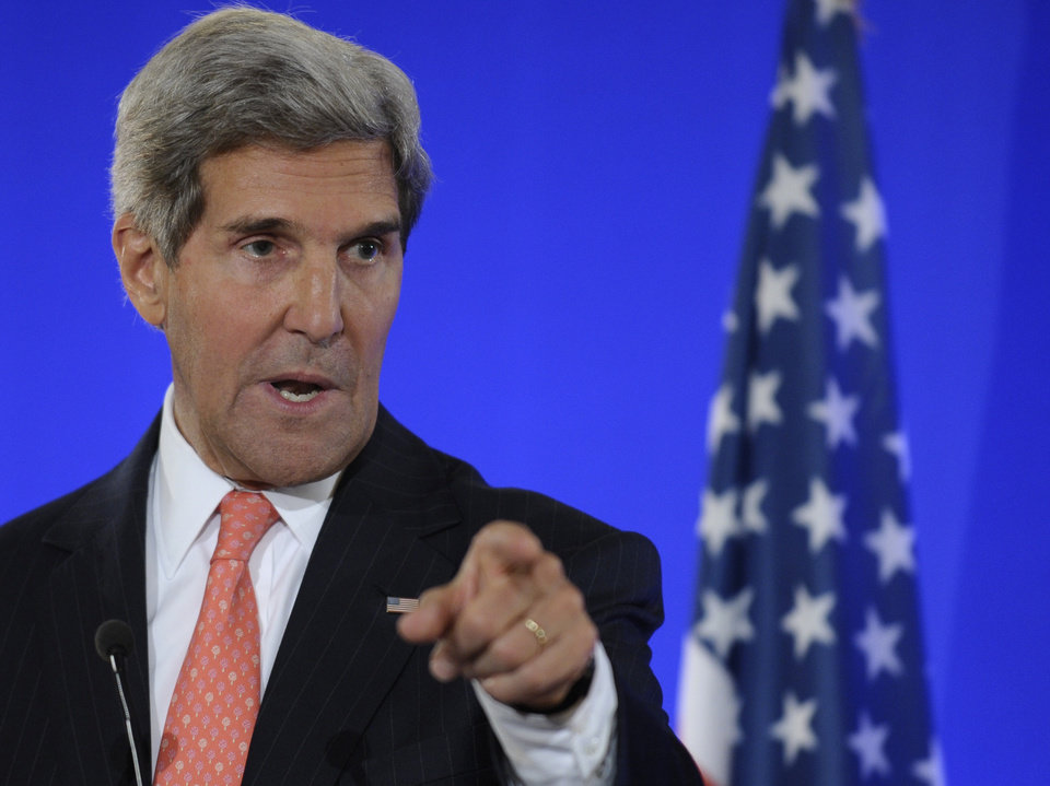 Photo - Secretary of State John Kerry speaks at joint press conference with French Foreign Minister Laurent Fabius (not shown) at the Ministry of Foreign Affairs in Paris, Saturday, Sept. 7, 2013. European foreign ministers on Saturday endorsed a