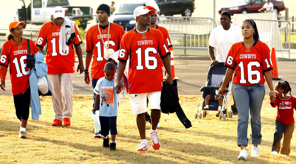 The family of Cowboy defensive back Perrish Cox including his father Perrish Sr. (center front) and sister Penny Cox (with jersey on right) parade to the field for the college football game between Oklahoma State University and Baylor University at Floyd Casey Stadium in Waco, Texas, Saturday, Nov. 17, 2007. BY STEVE SISNEY, THE OKLAHOMAN