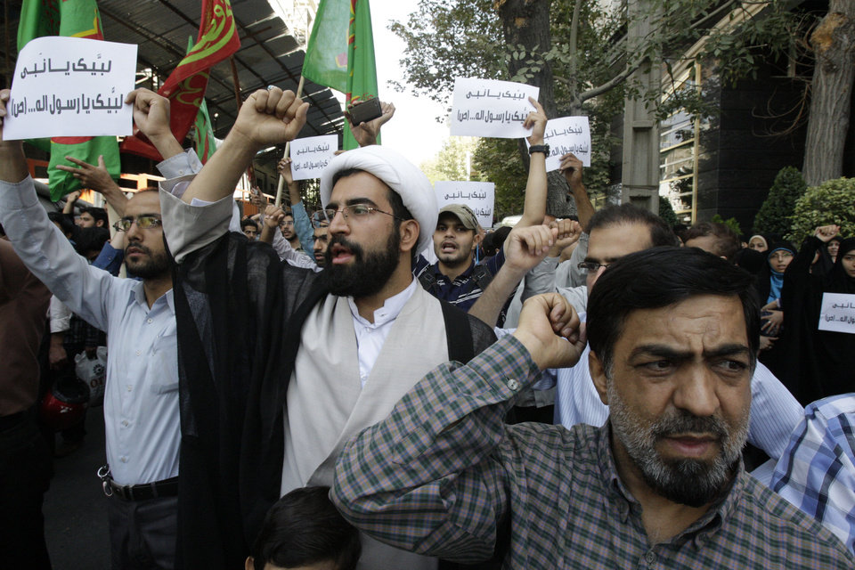 Photo -   Iranian protestors chant slogans during a demonstration against a film ridiculing Islam's Prophet Muhammad, in front of Swiss Embassy in Tehran, which represents US interests in Iran, Thursday, Sept. 13, 2012. The search for those behind the provocative anti-Muslim film led Wednesday to a California Coptic Christian convicted of financial crimes who acknowledged his role in managing and providing logistics for the production. Nakoula Basseley Nakoula, 55, told The Associated Press in an interview outside Los Angeles that he was manager for the company that produced