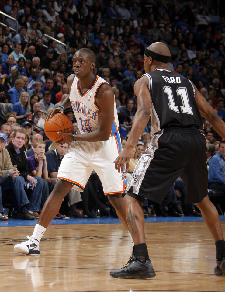 Oklahoma City Thunder's Reggie Jackson (15) looks to pass the ball as San Antonio Spurs' T.J. Ford (11) defends during the the NBA basketball game between the Oklahoma City Thunder and the San Antonio Spurs at the Chesapeake Energy Arena in Oklahoma City, Sunday, Jan. 8, 2012. Photo by Sarah Phipps, The Oklahoman