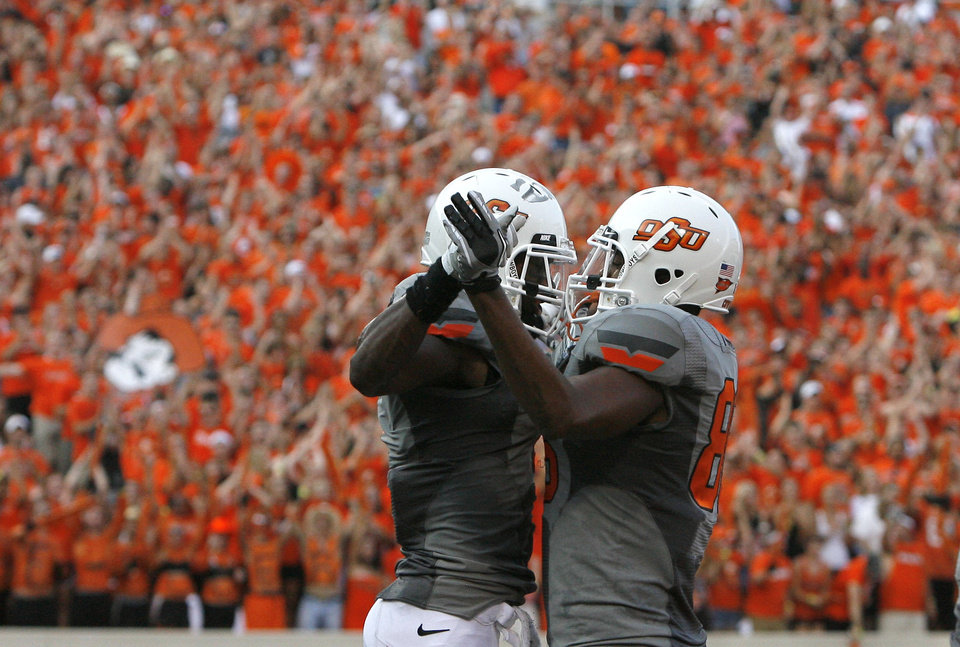 Oklahoma State\'s Joseph Randle and Tracy Moore celebrate a touchdown during the Cowboys game vs. La.-Lafayette on Saturday in Stillwater. Photo by Sarah Phipps, The Oklahoman