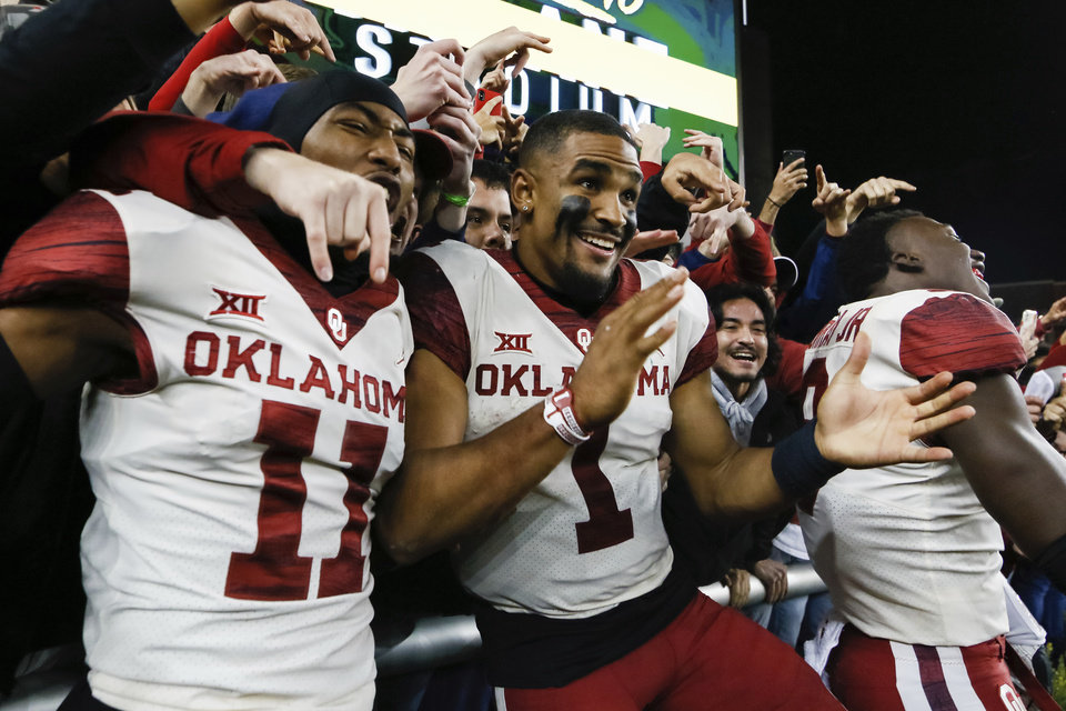 Photo - Oklahoma cornerback Parnell Motley (11) and quarterback Jalen Hurts (1) celebrate the 34-31 victory over Baylor following an NCAA college football game in Waco, Texas, Saturday, Nov. 16, 2019. (AP Photo/Ray Carlin)