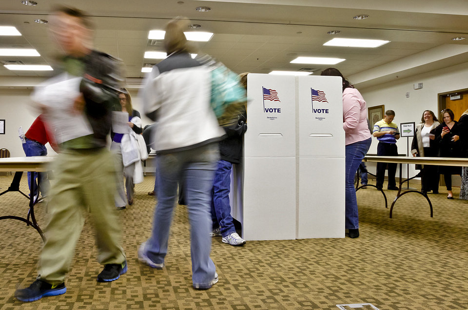 Photo - Voters file in to cast their vote during election day on Tuesday, Nov. 6, 2012, in Yukon, Oklahoma. Photo by Chris Landsberger, The Oklahoman