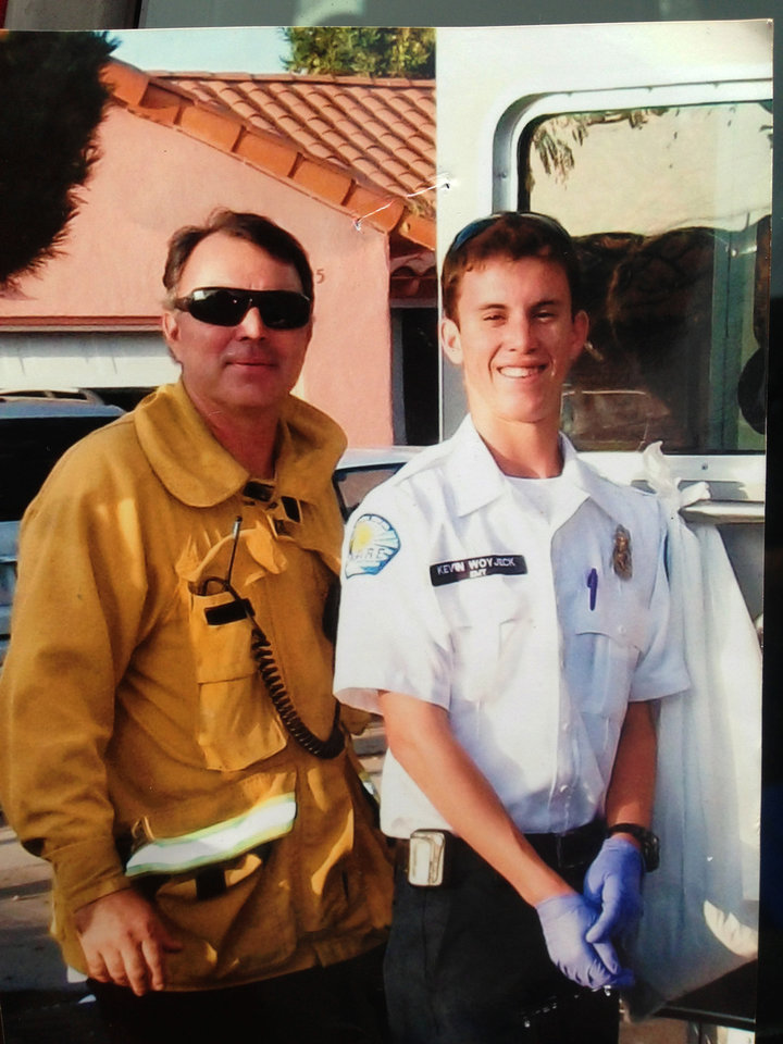 Photo - This undated photo courtesy of the the Woyjeck family shows firefighter, Kevin Woyjeck, right, and his father, Los Angeles County Fire Capt. Joe Woyjeck. Kevin Woyjeck of Seal Beach, Calif., was one of the 19 Granite Mountain Hotshot Crew, who was killed Sunday evening above the town of Yarnell, northwest of Phoenix in the nation's biggest loss of firefighters in a wildfire in 80 years. (AP Photo/Woyjeck Family)