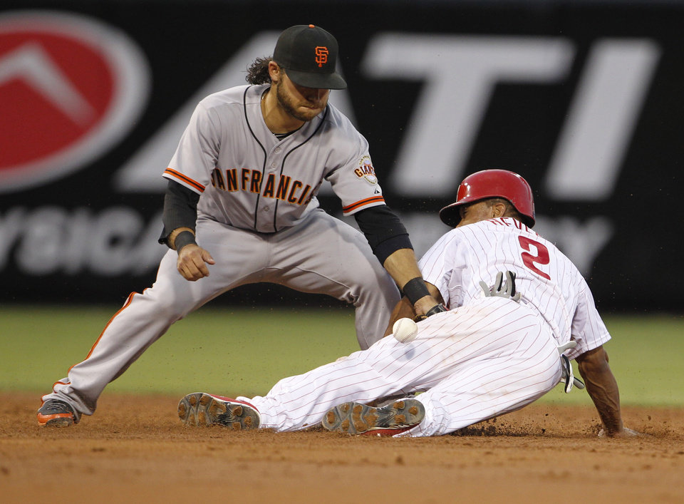 Photo - Philadelphia Phillies' Ben Revere gets a stolen base in the third inning of a baseball game as San Francisco Giants' Brandon Crawford covers on Tuesday, July 22, 2014, in Philadelphia. (AP Photo/The Philadelphia Inquirer, Ron Cortes)