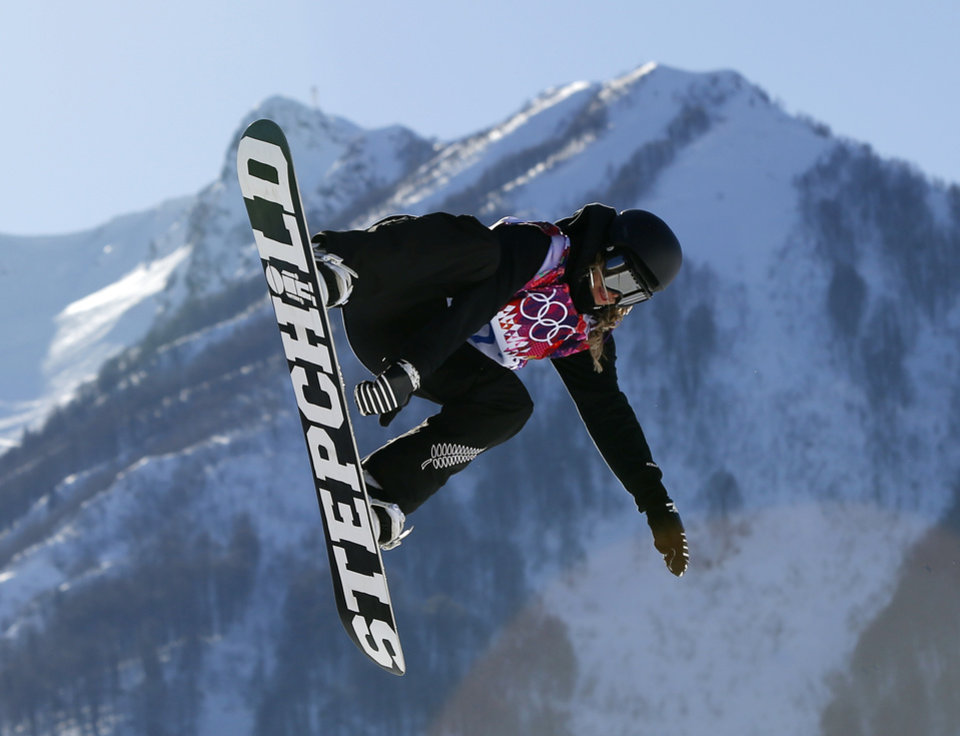 New Zealand's Rebecca Torr takes a jump during the women's snowboard slopestyle qualifying at the Rosa Khutor Extreme Park ahead of the 2014 Winter Olympics, Thursday, Feb. 6, 2014, in Krasnaya Polyana, Russia.  (AP Photo/Sergei Grits)