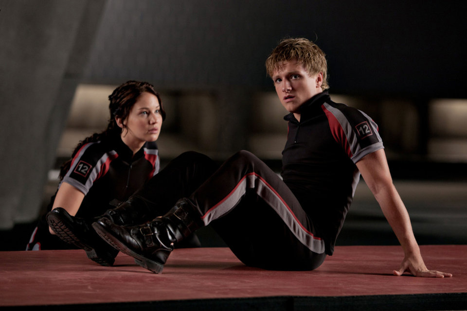 Photo - In this image released by Lionsgate, Jennifer Lawrence portrays Katniss Everdeen, left, and Josh Hutcherson portrays Peeta Mellark in a scene from