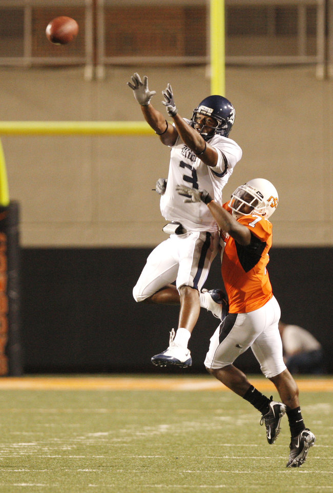 Photo - Rice wide receiver Toren Dixon (3) goes up for a catch as Maurice Gray (7) defends at the college football game between Oklahoma State University (OSU) and Rice University at Boone Pickens Stadium in Stillwater, Okla., Saturday, Sept. 19, 2009. Photo by Doug Hoke, The Oklahoman. ORG XMIT: KOD
