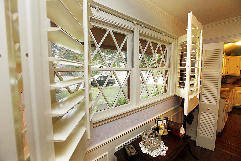 Photo - Diamond-pane windows, seen in Beverly Frantz's 1963 home, are the kind of features and finish that help make the