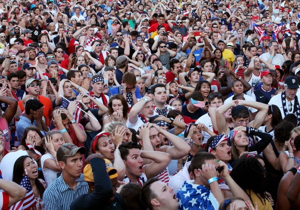 Photo - US soccer fans react to Portugal's tie-goal near the end of the game as they watch the game between US and Portugal in Richmond, Va., on Sunday, June 22, 2014.   (AP Photo/Richmond Times-Dispatch, Daniel Sangjib Min) (
