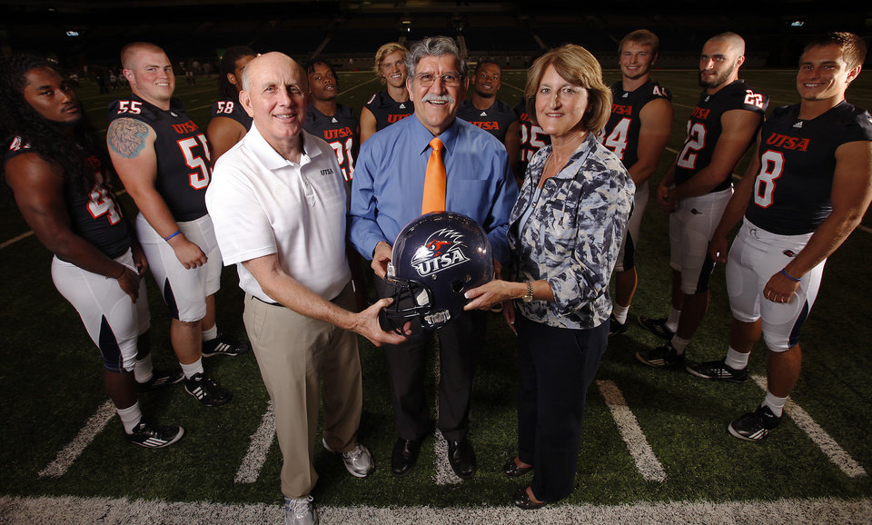 Photo - UTSA President Ricardo Romo (center) is joined by football head coach Larry Coker (left) and athletic director Lynn Hickey (right) for a portait on Media Day for the UTSA football program at the Alamodome on Friday, August 19, 2011. Kin Man Hui/kmhui@express-news.net