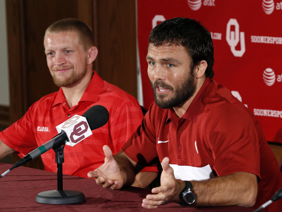 Photo - Jared Frayer (right) gestures during a press conference on Thursday, July 5, 2012 in Norman, Okla. He and fellow wrestler Sam Hazewinkel (left) are among six athletes from the University of Oklahoma who have qualified for the 2012 London Olympics in track and field, wrestling and men's gymnastics  Photo.  Photo by Steve Sisney, The Oklahoman