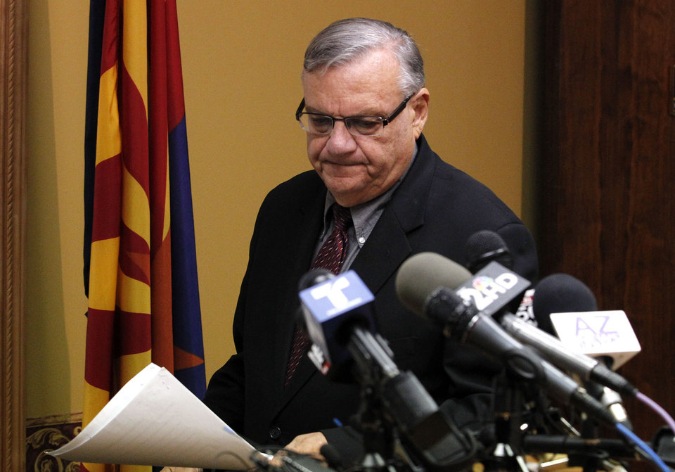 Photo - Maricopa County Sheriff Joe Arpaio, arrives to answer questions regarding the Department of Justice announcing a federal civil lawsuit against Sheriff Arpaio and his department, prior to a news conference Thursday, May 10, 2012, in Phoenix.  According to the Department of Justice, after months of negotiations failed to yield an agreement to settle allegations that the sheriff's department racially profiled Latinos in his trademark immigration patrols, the lawsuit was filed. (AP Photo/Ross D. Franklin, file)