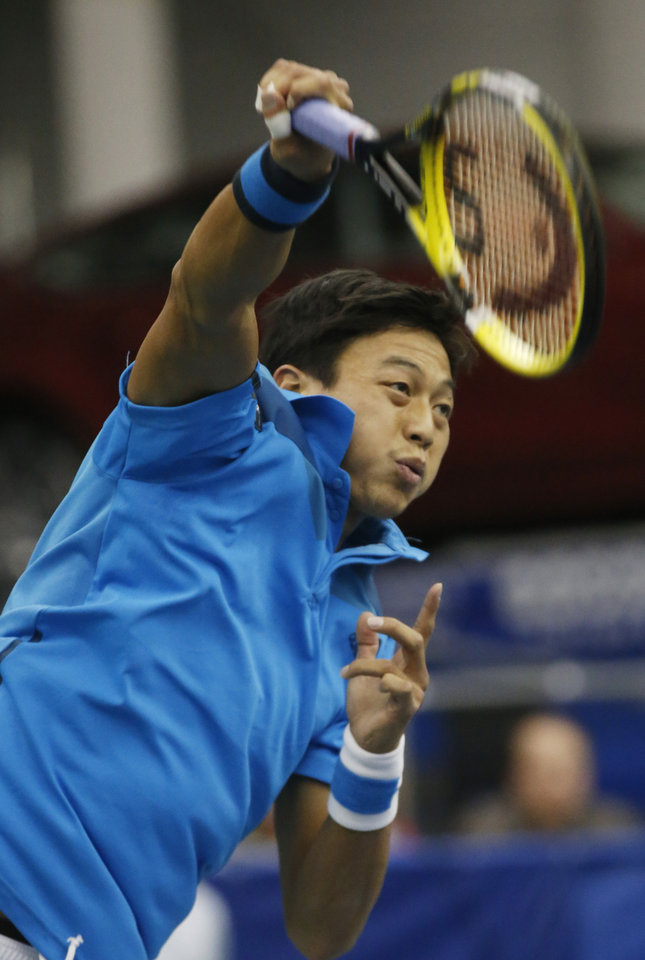 Photo - Lu Yen-hsun. pf Taiwan, serves to Ivo Karlovic, of Croatia, during the semifinals of the U.S. National Indoor Tennis Championships on Saturday, Feb. 15, 2014, in Memphis, Tenn. Lu retired due to injury after losing the first set, (AP Photo/Rogelio V. Solis)