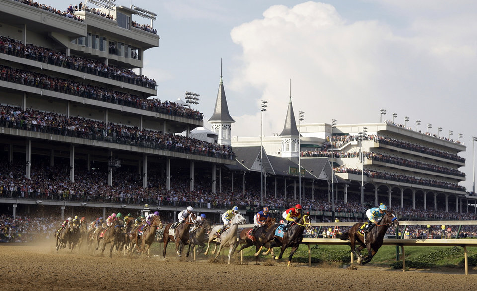 Photo - Bodemeister with jockey Mike Smith leads the field around the first turn in the 138th Kentucky Derby horse race at Churchill Downs Saturday, May 5, 2012, in Louisville, Ky. (AP Photo/Darron Cummings) ORG XMIT: DBY198