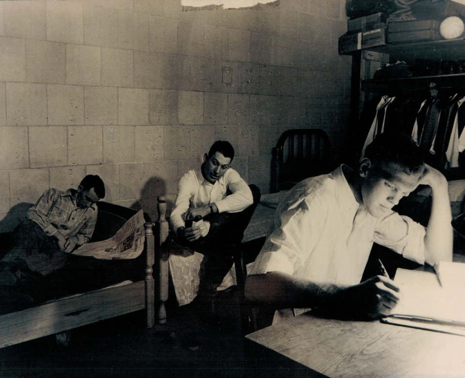 "Photo -  Oklahoma State's Bob Kurland (right), Joe Halbert (center) and Bob ""Pee Wee"" Williams study in their room in Gallagher Hall. PHOTO PROVIDED"