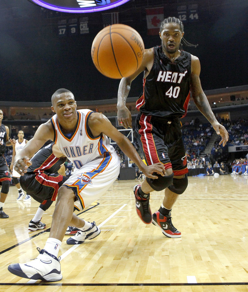 Oklahoma City's Russell Westbrook and Miami's Udonis Haslem go for the ball during an NBA preseason game between the Oklahoma City Thunder and the Miami Heat at the BOK Center in Tulsa, Okla., Wednesday, October 14, 2009. Photo by Bryan Terry, The Oklahoman